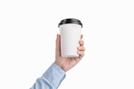 Male hand holding a white coffee cup isolated on white background Archivio Fotografico