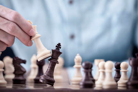Businessman play with chess game in competition success play, concept strategy and successful management or leadership Archivio Fotografico - 151333435