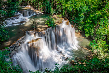 Beautiful waterfall nature scenery of deep forest in summer day