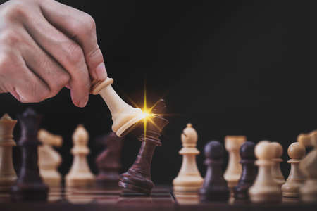 Businessman play with chess game in competition success play, concept strategy and successful management or leadership Archivio Fotografico - 152417527