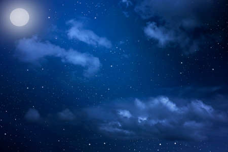 Starry night sky with stars and moon in cloudscape background Archivio Fotografico