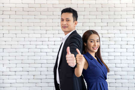 Business partnership entrepreneur working showing sign of success , thumbs up looking at camera Archivio Fotografico - 154734759