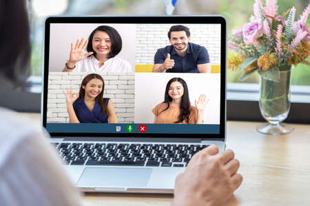 Back view of woman talking to video chat with colleagues using laptop webcam in video conference , Business team smart working online meeting in video call from home