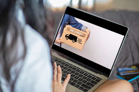 Beautiful young asian woman using laptop online ordering take away by internet , Online shopping , ecommerce and delivery service concept Archivio Fotografico