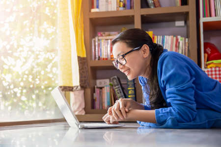 Happy young asian woman online using laptop while connection on video call , Beautiful woman speaking looking at camera talking with her friend video call at home