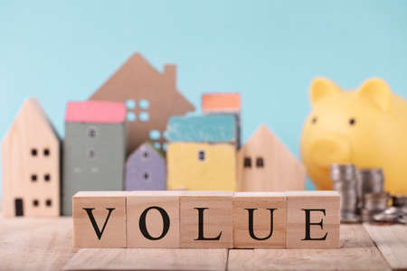 Wooden blocks with the word Value , Planning for the future of rent for an apartment or home concept .The best value of the apartment or house for sale. Real estate market. Archivio Fotografico