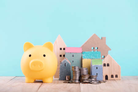 Piggy bank for save for home ,Planning for the future of rent for an apartment or home concept .The best value of the apartment or house for sale. Real estate market.