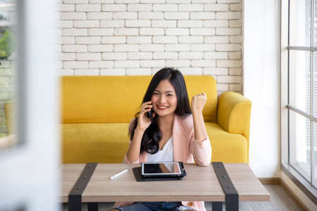 Startup successful entrepreneur small business woman online using laptop receive order from customer at her home office , online shopping marketing and stay at home concept