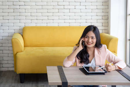 Business asia woman using laptop receive order from customer at her home office , Startup successful entrepreneur small business , online shopping marketing and stay at home concept
