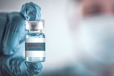 Blue vaccine jar bottle for treatment from corona virus infection and build immunity to viruses Covid-19 , Healthcare And Medical concept. Archivio Fotografico