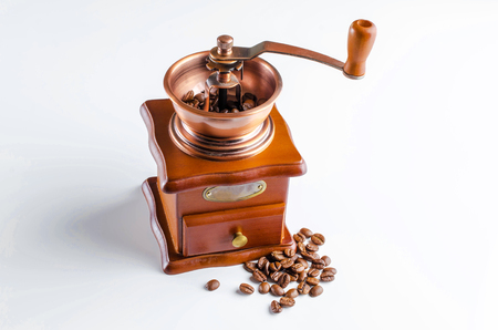 Coffee grinder with roasted coffee beans isolated on white background. Banco de Imagens