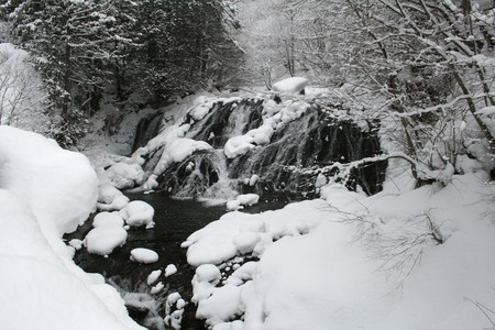 Winter and snow freeze down waterfall 写真素材