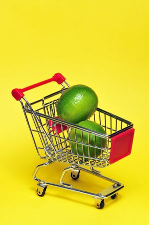 Limes in a shopping cart. Stock Photo - 4976124