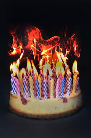 Birthday cake on fire Stock Photo