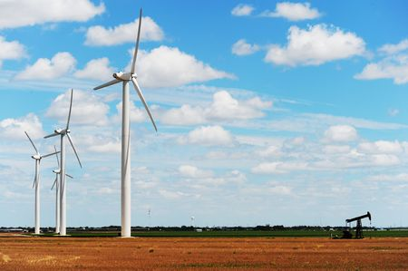sweetwater: Wind Turbines with old oil well pump in Sweetwater,Texas Stock Photo