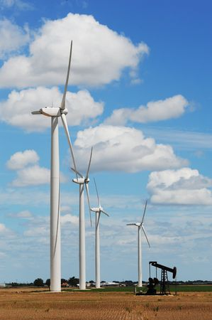 sweetwater: Wind Turbines with old oil well pump in Sweetwater,Texas. Stock Photo