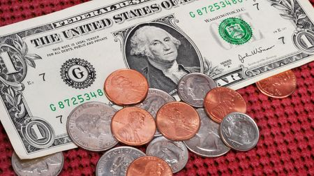 nickle: Money for tips at the restaurant. Stock Photo