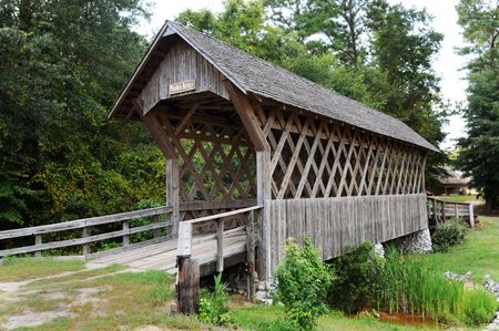 troy: Old wooden covered bridge in Troy,Alabama. Stock Photo