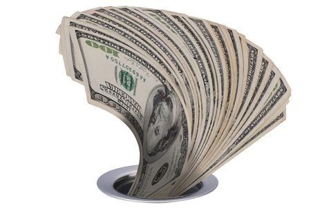 Money down the kitchen drain. Stock Photo