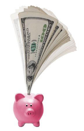 Money coming out of a pink piggy bank. Stock Photo