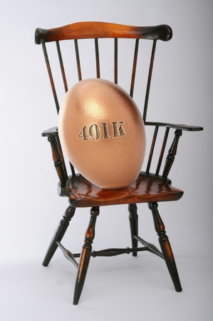 Golden retirement egg. Archivio Fotografico
