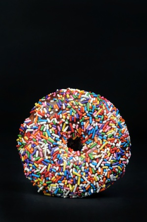 Rainbow Sprinkled Doughnut. Stock Photo - 10282674