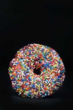Rainbow Sprinkled Doughnut. Stock Photo - 10282674