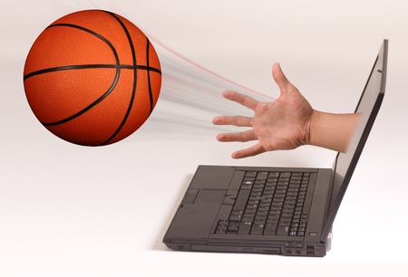 coming out: Basketball Coming Out of Computer Screen.