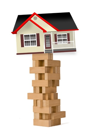 Home investment on blocks and ready to fall Stock Photo - 12441858