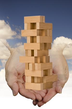 game block: Toy Blocks and Hands from Heaven  Stock Photo