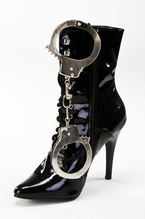 Boots and Handcuffs. Stock Photo