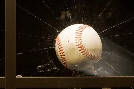 Baseball Shatters Window