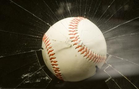 Baseball Shatters Window  photo