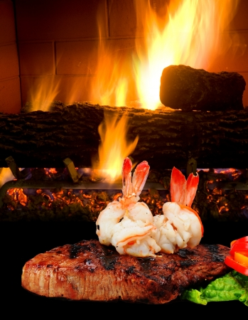 woodburning: Steak and Shrimp by the Fireplace  Stock Photo