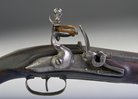 muzzleloader:   Closeup of French flintlock pistol made around 1800