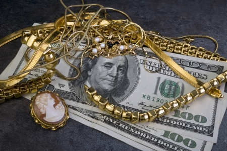 sell: Scrap Gold Is Worth Cash. Stock Photo