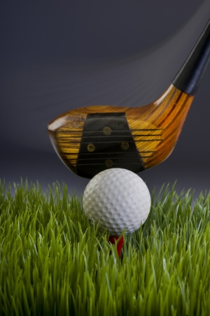 Golf ball with wooden driver showing motion Stock Photo - 18819136