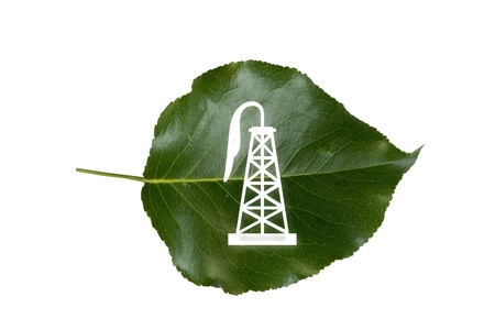 Oil Derrick on Green Leaf  photo