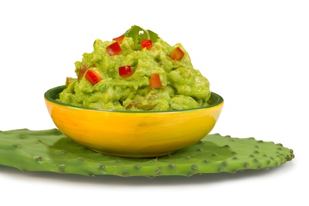 tex mex: Guacamole dip on green cactus leafs