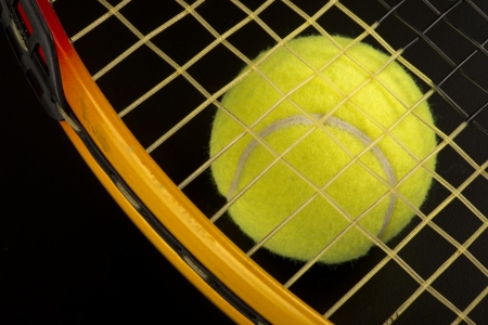 Tennis ball and racket  Stock Photo - 22973556