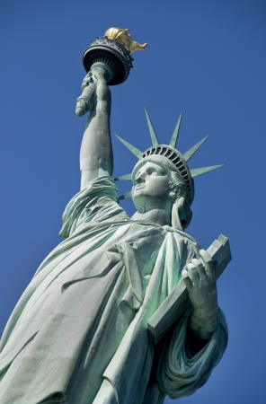 Statue of Liberty on Hudson River in NYC  photo