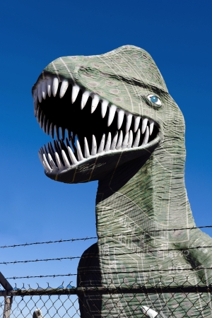 trapped: Dinosaur trapped behind barbed fence