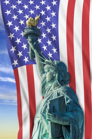 Statue of liberty with old glory in background. Stock Photo - 23991078