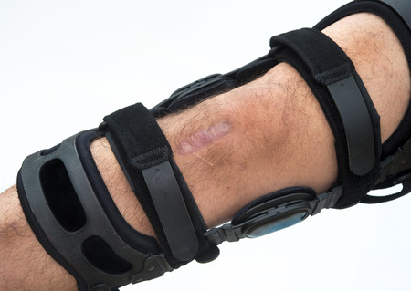 Knee brace for ACL football knee injury Stock Photo - 24540321