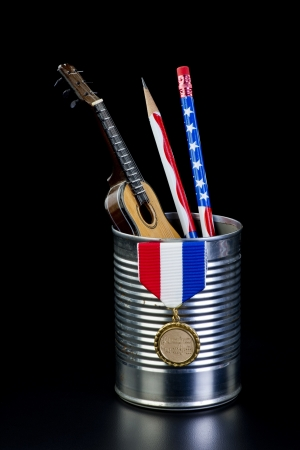 Tin can full of guitar,pencils and awards  Stock Photo - 24540330