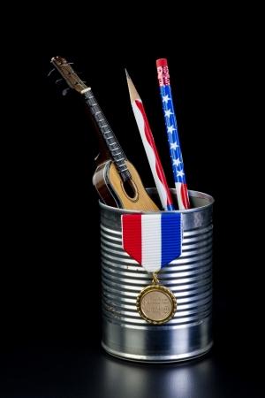 Tin can full of guitar,pencils and awards Stock Photo - 24540330