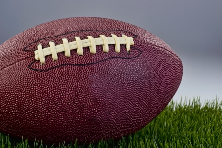 youth football: Leather football on green grass field. Stock Photo