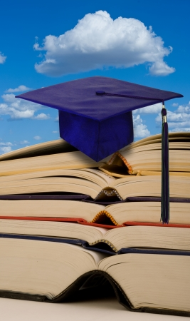 Education with books and graduation. Stock Photo - 25309498