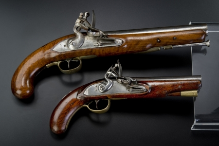 flintlock: A pair of 18th century British flintlock pistols.