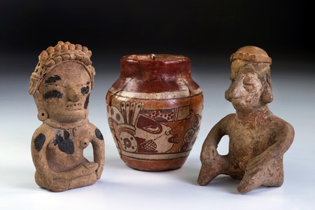 indian artifacts: Pre Columbian warriors and pottery made from 600AD to 100BC.  Mayan god painted on pottery.